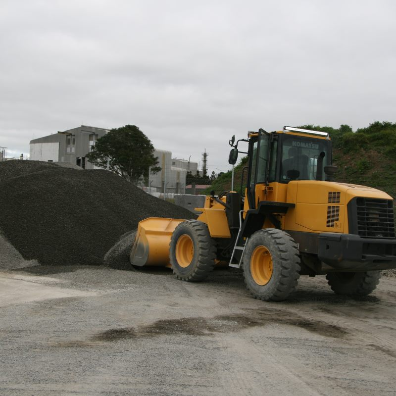 digger moving gravel for concrete